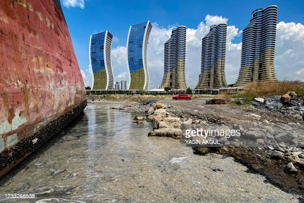 Abandonned ship surrounded by mucilage is pictured on the Marmara sea in Istanbul, on June 4, 2021. - The mucilage, also reffered to as sea snot, is...