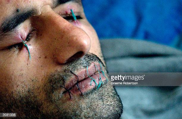 Abas Amini an Iranian Kurdish refugee sits in protest May 27 2003 in Nottingham England Abas Amini was granted asylum two months ago but since has...