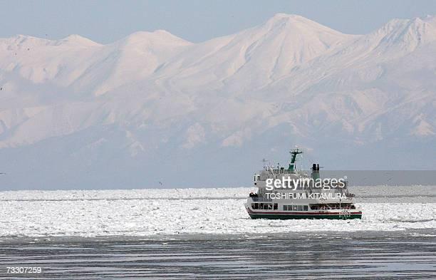 A cruise boat sails among drifting ice on the Sea of Okhotsk off the Abashiri port in Abashiri city some 1000 kilometres north of Tokyo 10 February...