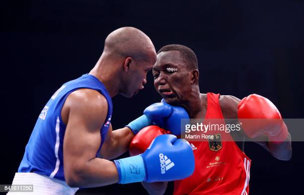 Abass Baraou of Germany and Roniel Iglesias of Kazachstan fight in the Men's welter during the semi finals of the AIBA World Boxing Championships...