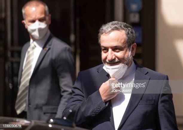 Abbas Araghchi , political deputy at the Ministry of Foreign Affairs of Iran, takes his mask off as he is leaving the 'Grand Hotel Wien' after the...