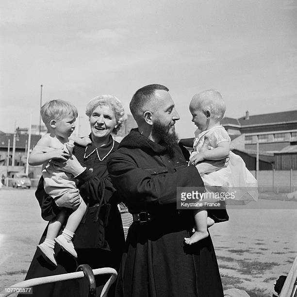Abbe Pierre With A British Trailer Family Which Projects To Make The World Tour On July 25Th 1954