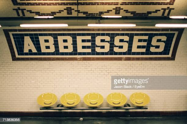 Abbesses Text On Wall At Metro Station