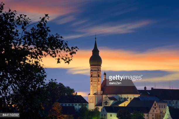 Abbey Church of Andechs monastery (Kloster Andechs) against colorful sunset sky, Upper Bavaria, Germany