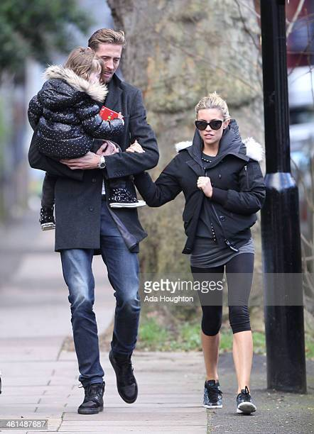 Abbey Clancy and Peter Crouch and their daughter are pictured out in North London on January 9 2014 in London England