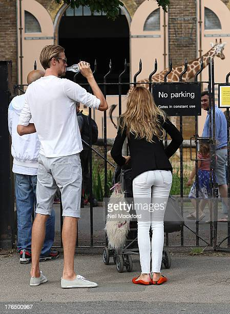 Abbey Clancy and Peter Crouch are pictured at ZSL London Zoo on August 14 2013 in London England