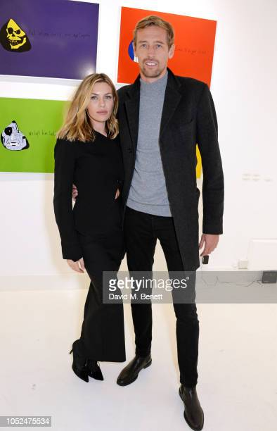 Abbey Clancy and Peter Crouch attend a private view of Daft Apeth by Serge Pizzorno of Kasabian at No Ho Showrooms on October 18 2018 in London...