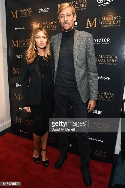 Abbey Clancy and Peter Crouch attend the private view of leading wildlife photographer David Yarrow's exhibition at Maddox Gallery Westbourne Grove...