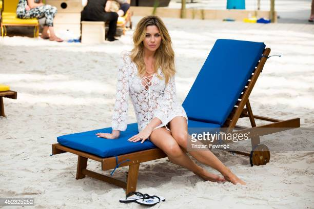 Abbey Clancy attends a photocall to launch the Scholl Pop Up Pedicure Beach at Westfield on July 18 2014 in London England