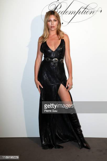 Abbey Clancy attends the Redemption Haute Couture Fall/Winter 2019 2020 show as part of Paris Fashion Week on June 30, 2019 in Paris, France.