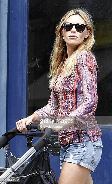 Abbey Clancy is spotted out and about in North London with their daughter Liberty Rose on July 22 2015 in London England