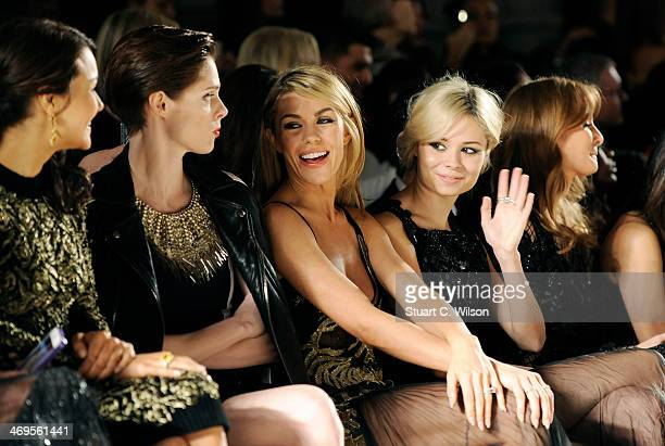 Abbey Clancy Nina Nesbitt and Milly Mackintosh attend the Julien Macdonald show at London Fashion Week AW14 at Royal Courts of Justice Strand on...