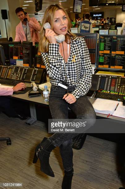 Abbey Clancy representing Children With Cancer makes a trade at BGC Charity Day at One Churchill Place on September 11 2018 in London England