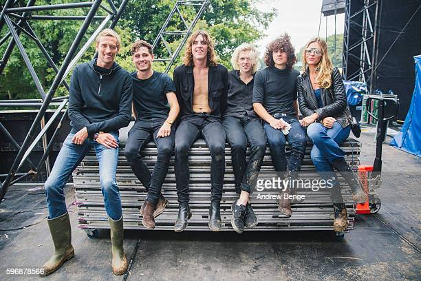 Abbey Clancy with her brothers band Juda poses with Peter Crouch backstage on day 3 of Leeds Festival 2016at Bramham Park on August 28 2016 in Leeds...