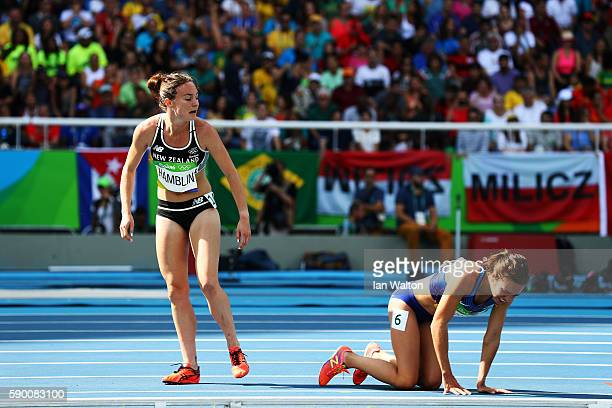 Abbey D'Agostino of the United States and Nikki Hamblin of New Zealand react after a collision during the Women's 5000m Round 1 Heat 2 on Day 11 of...