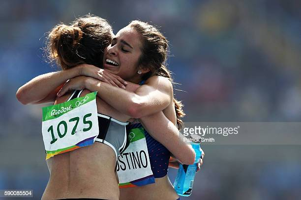 Abbey D'Agostino of the United States hugs Nikki Hamblin of New Zealand after the Women's 5000m Round 1 Heat 2 on Day 11 of the Rio 2016 Olympic...