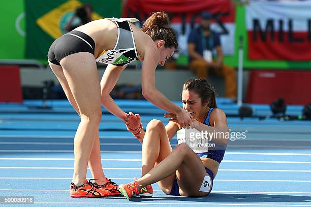Abbey D'Agostino of the United States is assisted by Nikki Hamblin of New Zealand after a collision during the Women's 5000m Round 1 - Heat 2 on Day...