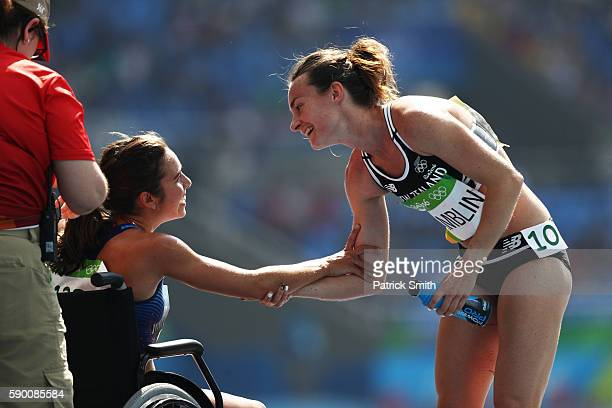 Abbey D'Agostino of the United States talks with Nikki Hamblin of New Zealand after the Women's 5000m Round 1 Heat 2 on Day 11 of the Rio 2016...