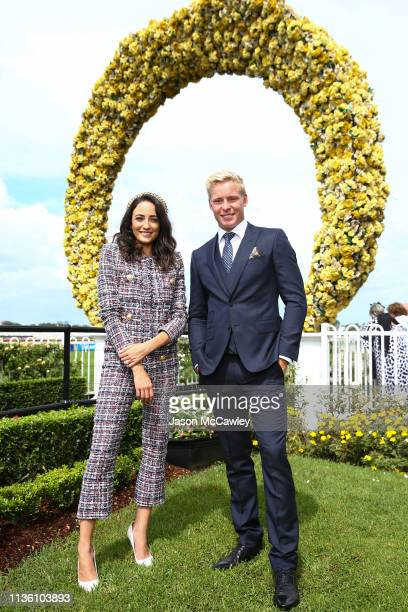 Abbey Gelmi and Isaac Heeney pose at Rosehill Gardens on March 16, 2019 in Sydney, Australia.