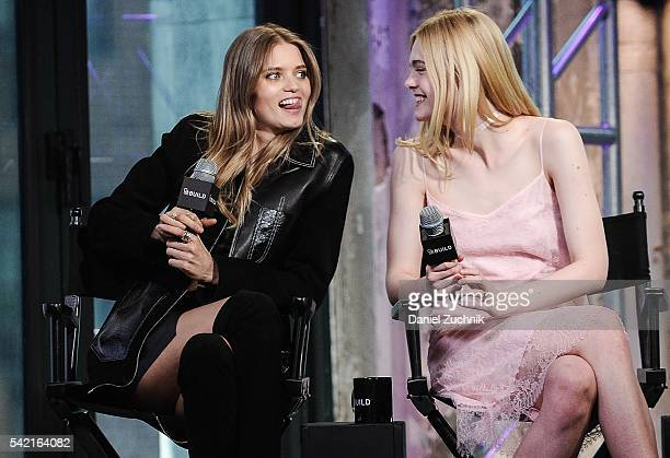 Abbey Lee and Elle Fanning attend AOL Build to discuss the film 'The Neon Demon' at AOL Studios on June 22 2016 in New York City