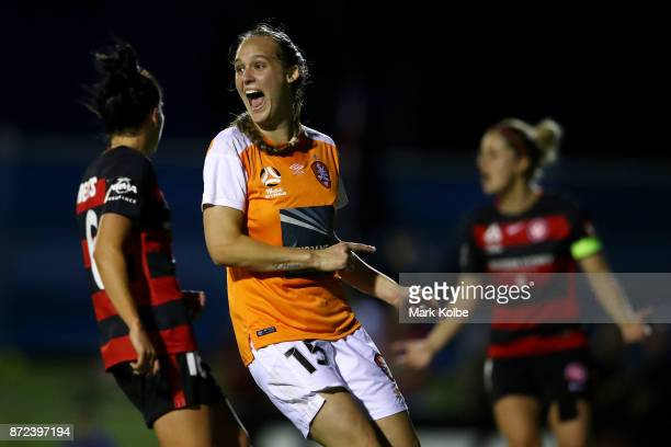 Abbey Lloyd of the Roar celebrates after Carson Pickett scored a goal during the round three WLeague match between the Western Sydney Wanderers and...