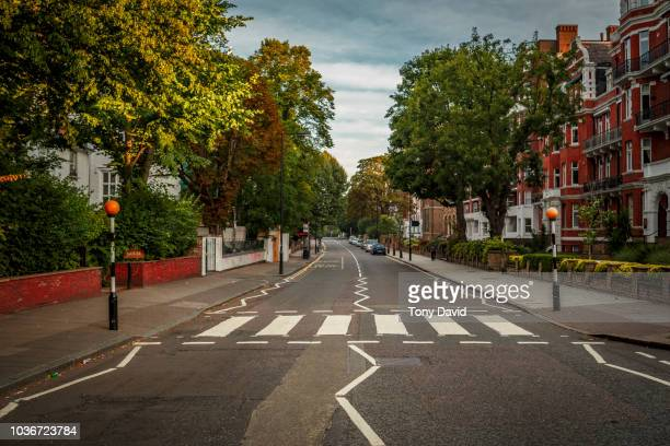 abbey road with the most famous road crossing in the world - abbey road stock photos and pictures
