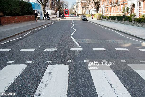 abbey road zebra crossing london uk - abbey road stock photos and pictures
