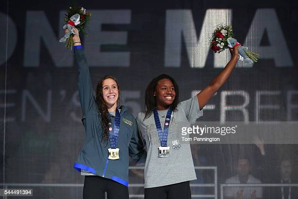 Abbey Weitzeil and Simone Manuel the United States participate in the medal ceremony for the Women's 50 Meter Freestyle during Day Eight of the 2016...