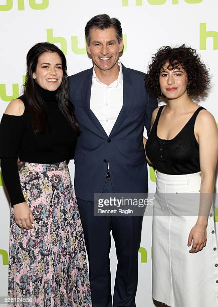 Abbi Jacobson and Ilana Glazer of Broad City pose with Hulu CEO Mike Hopkins at the 2016 Hulu Upftont on May 04 2016 in New York New York