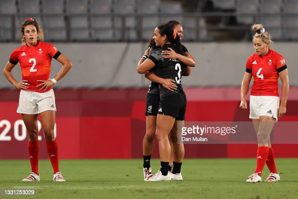 Abbie Brown and Natasha Hunt of Team Great Britain look dejected after defeat as Ruby Tui of Team New Zealand and Stacey Fluhler of Team New Zealand...