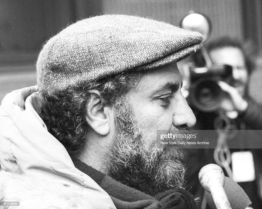 Abbie Hoffman enters Police Headquarters to apply for access : News Photo