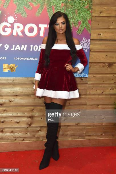 Abbie Holborn attends a Christmas Photocall in Santa's Grotto Leicester Square on December 5 2017 in London England