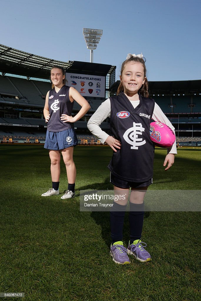 Abbie McKay and Stacey Kitto pose for a photo wearing the Carlton Blues jumper during an AFL media opportunity to announce the competing teams in next year's inaugural Women's National League at Melbourne Cricket Ground on June 15, 2016 in Melbourne, Australia.