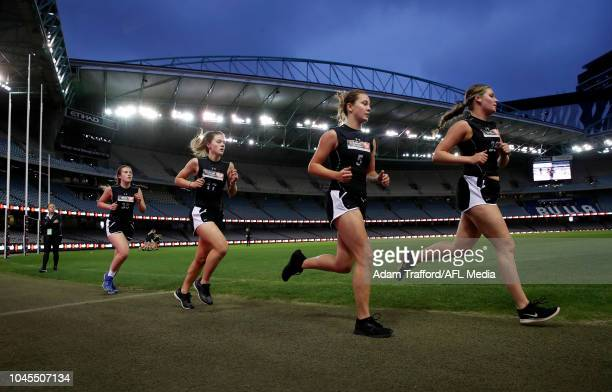 Abbie McKay Madeline Brancatisano Natalie Grider and Rebecca Webster compete in the 2km time trial during the AFLW Draft Combine at Marvel Stadium on...