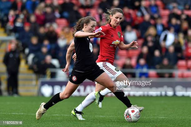 Abbie McManus of Manchester United Women and Charlie Wellings of Bristol City Women during the Barclays FA Women's Super League match between...