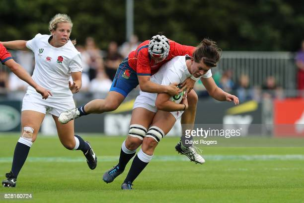 Abbie Scott of England is tackled by Elena Redondo of Spain during the Women's Rugby World Cup 2017 match between England and Spain on August 9 2017...