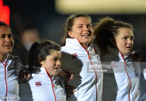 Abbie Scott of England sings the National Anthem during the Natwest Women's Six Nations match between Scotland Women and England Women at Scotstoun...
