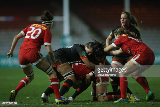 Abbie Scott of England Women puts in a tackle during the Old Mutual Wealth Series match between England Women and Canada Women at Twickenham Stoop on...