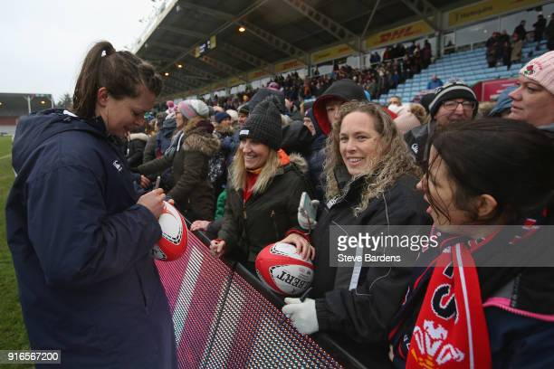 Abbie Scott of England Women signs autographs for supporters after the Natwest Women's Six Nations Championships match between England and Wales at...