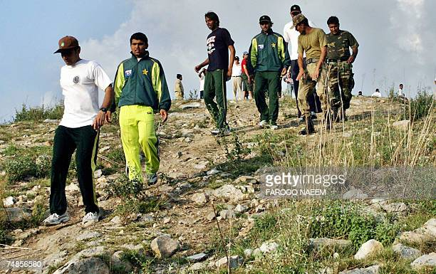 TO GO WITH CRICKETPAKINDSCOMILITARY In this picture taken 21 June 2007 Pakistani cricketers MisbahulHaq Kamran Akmal Mohammad Asif and Mohammad Hafiz...
