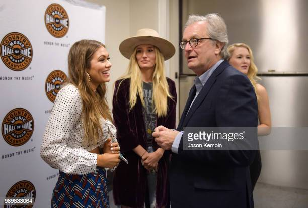 Abby Anderson Ruby Stewart and Director and CEO of the Country Music Hall of Fame and Museum Kyle Young visit CMA Theater on June 8 2018 in Nashville...