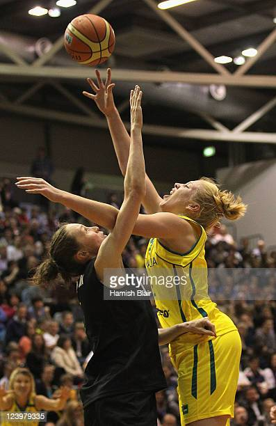 Abby Bishop of Australia shoots over Antonia Edmondson of New Zealand during the first match between the Australian Opals and the New Zealand Tall...