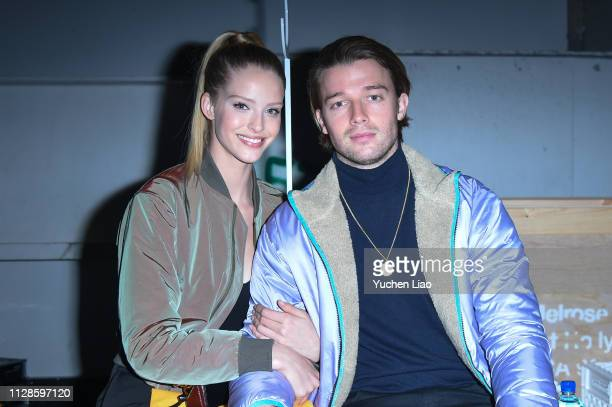 Abby Champion and Patrick Schwarzenegger attend John Elliott in Front Row at February 2019 New York Fashion Week The Shows on February 09 2019 in New...