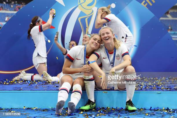 Abby Dahlkemper and Samantha Mewis of the USA celebrate victory in the 2019 FIFA Women's World Cup France Final match between The United States of...