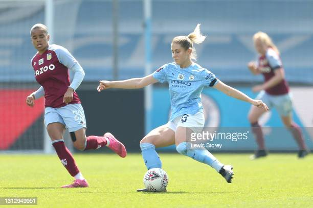 Abby Dahlkemper of Manchester City passes the ball under pressure from Shania Hayles of Aston Villa during the Vitality Women's FA Cup Fourth Round...