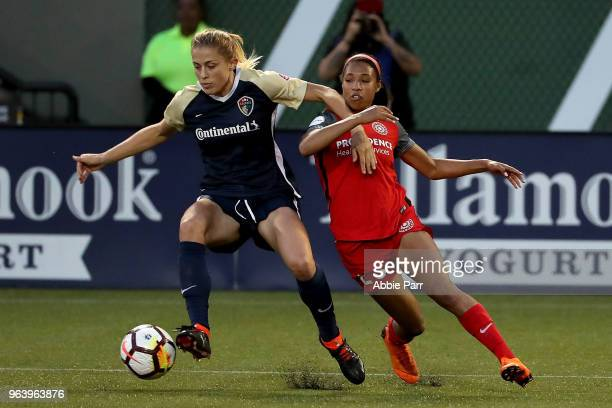 Abby Dahlkemper of North Carolina Courage dribbles against Margaret Purce of Portland Thorns FC in the second half during their game at Providence...