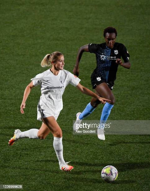 Abby Dahlkemper of North Carolina Courage drives past Ifeoma Onumonu of Sky Blue FC during a game on day 8 of the NWSL Challenge Cup at Zions Bank...