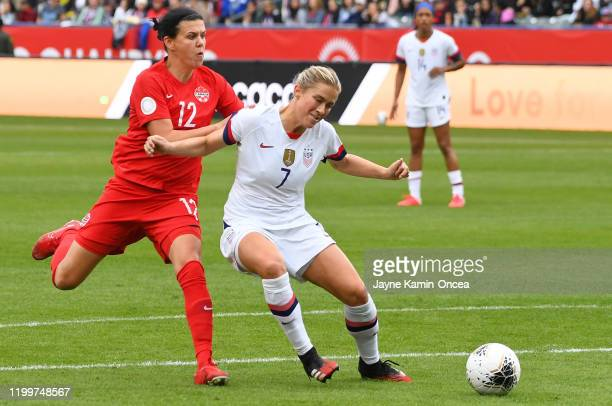 Abby Dahlkemper of the United States defends a shot on goal by Christine Sinclair of Canada in the first half of the CONCACAF Women's Olympic...