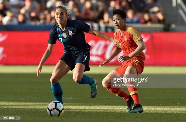 Abby Dahlkemper of the United States directs the ball past defender Li Ying of China in the first half of an international friendly soccer match at...