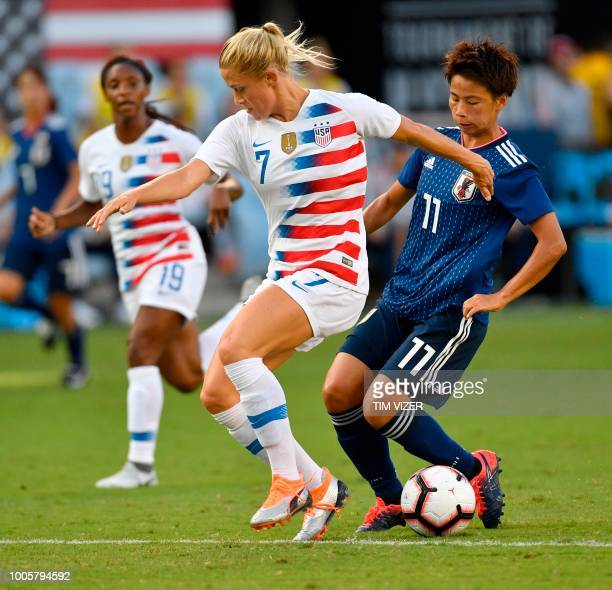 Abby Dahlkemper of USA and Mina Tanaka of Japan vie for the ball in the second of two Tournament of Nations games at Children's Mercy Park in Kansas...
